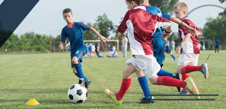 bambini-gioco-del-calcio-min